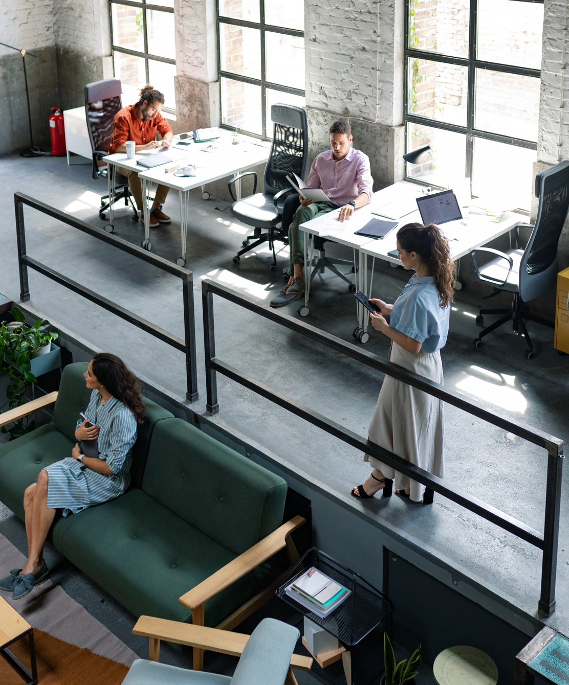 Wide Angle View of a Modern Loft Open Space Office With Businesspeople Working in It
